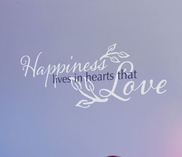 Happiness lives in hearts that love Wall Decal
