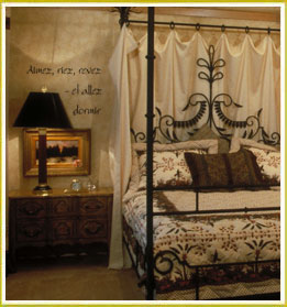 bedroom wall lettering decal above bedside drawer and lamp in French bedroom