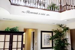 italian hospitality wall lettering along balustrade