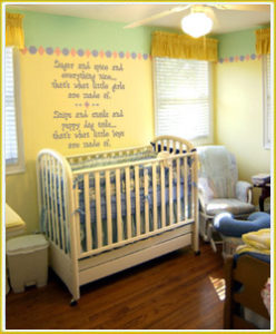 kid's wall lettering beside crib in baby's room
