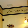 Mon Doux Foyer wall decal above the wall sconce and right before the wall partition to the ceiling.