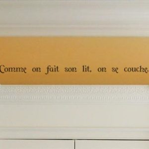 Comme on fait son lit, on se couche. Wall Decal