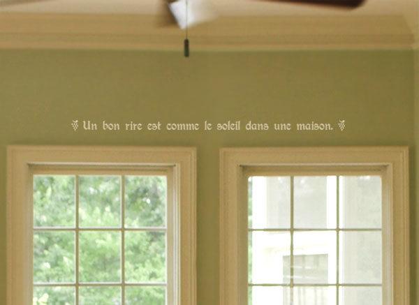 Un bon rire est comme le soleil dans une maison. Wall Decal