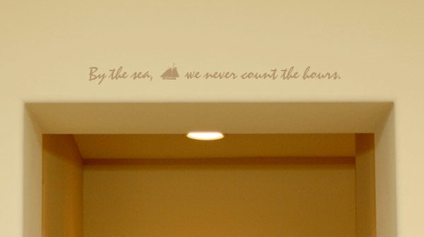 By the sea, we never count the hours Wall Decal