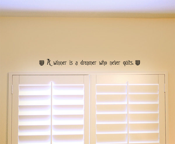 A winner is a dreamer who never quits. Wall Decal