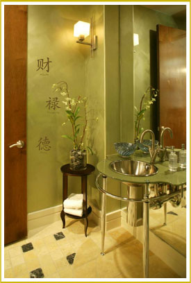 style wall art decal beside door in Asian bathroom