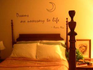 bedroom wall art decal above headboard in moon themed bedroom