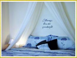 bedroom wall decal words below crown curtain in bedroom
