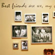 A wall decal about friendship with black and white pictures of friends in different sizes hanging on the wall.