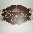 A wall decal with brown fonts and fancy ends - Brynlee