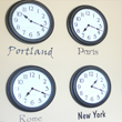 City names wall decal with timepiece on each name stating its different time zones - Portland , Paris, Rome, New York