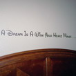 A Dream is a Wish Your Heart Makes - A Disney wall quotation above the bed's headboard in the kids room.