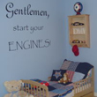Wall lettering above the wooden baby boy's crib - Gentlemen Start your Engines