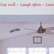 Wall Quotation on a drop ceiling in the entrance of a dining room .Eat Well - Love Often - Love