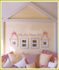 photo wall decal on wall above pillows