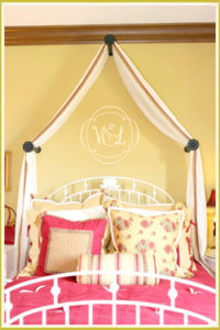 kid's room wall monogram decal below curtain canopy in girl's room