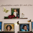 A Wall decal about family with 3 family pictures and pasted butterfly decors