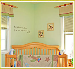 kids room decal on wall above crib in boy's nursery room