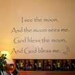 I see the moon, and the moon sees me. God bless the moon and god bless me, a wall decal above the wallpaper design in the bedroom with a lampshade on the side
