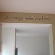 An Italian wall decal on the passageway ceiling beam - Chi mangia bene, vive bene