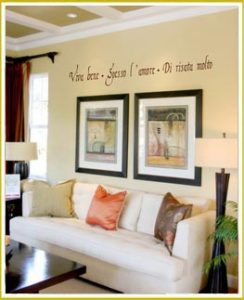 language wall lettering above two large pictures in living room
