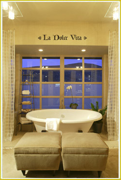 inspirational wall lettering above large glass paneled window in Italian bathroom