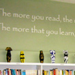Wall quote above book shelf in a school library by Dr Suess - the more you read, the more you'll learn