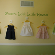 Treasure Life's Little Moments on a wall hung with five cute little dresses in a Little Girl's Room. Life's Little Moments