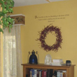 Wall words above the bookshelves and a window with drapery window box on the left side