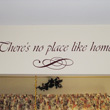 Wall quotes above the window with curtain and a lettering art just below the wall decal - There's no place like home