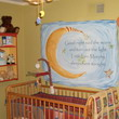Wall decal with moon design on the side and a crib on the center in the baby's room