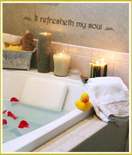 inspirational wall lettering above bathtub in bathroom