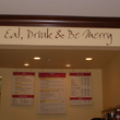 Eat, Drink, and be merry - wall decal on the overhead beam in the cafe area.