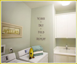 wall words in laundry room over washing machine wash dry fold repeat