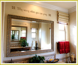 inspirational wall decal art above large mirror in bathroom