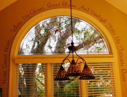 Wall decal on the colonial design window with blinds and a hanging chandelier