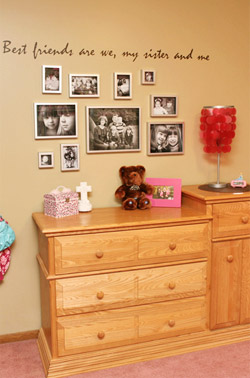 A wall lettering with the best friend's photo collage, and a dresser in the bedroom.
