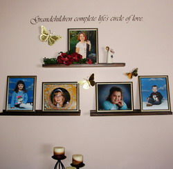 GrandChildren Complete Life's Circle of Love - Wall quotation on top of children's pictures on the shelves attached to a lavender wall.