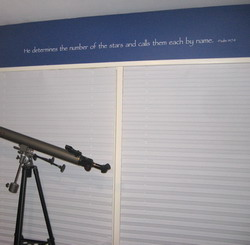 He determines the number of the stars and call them each by name, Psalm 147:4.Star Gazing in a binocular telescope on a white horizontal window blinds inside the astronomy themed bedroom.