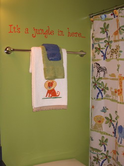 Children's bathroom wall decal above the water closet and near the shower curtain - Its a Jungle in here