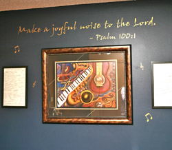 A bible verse wall quotation with 3 picture frames and musical notes on the background - Make a joyful noise to the lord. Psalm 100:1