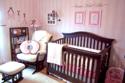Mia's Room - A wall decal above the wooden Crib in a nursery room.