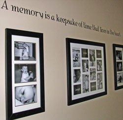 A wall decal with collage of pictures on the hallway -A memory is a keepsake of time that lives in the heart