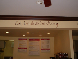A Wall decor on the overhead beam in the cafe area - Eat, Drink & be Merry