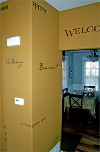 Welcome, wall decal facing the dining room with an earth-color design motif of the interior