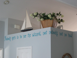 Nobody gets in to see the wizard, Not nobody not no how!A wall lettering on the overhead partition with a sailboat and flowers as accessories.